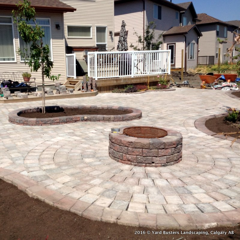 Large Stone Patio In Circular Pattern By Yard Busters Landscaping Of Calgary