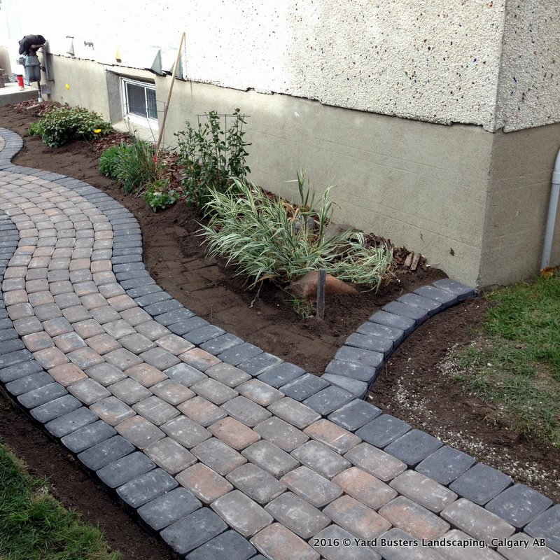 Landscaping Bricks Calgary : Stone patio in circular pattern by yard busters landscaping of calgary