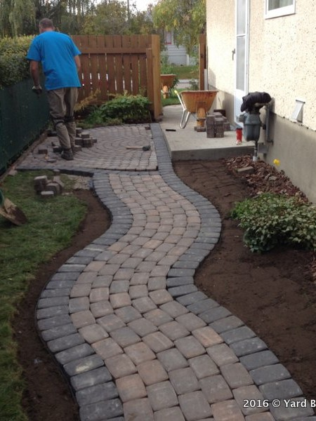 Before And After Interlock Curving Pathway Yard Busters Landscaping And Yard Care Calgary